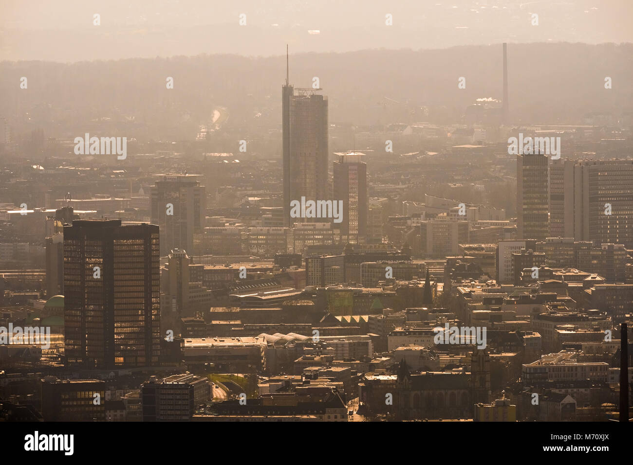 The skyline, from Essen im Smog, seen from the north, with Rathaus Essen and RWE-Turm, in Essen in NRW. Diesel driving - Stock Image
