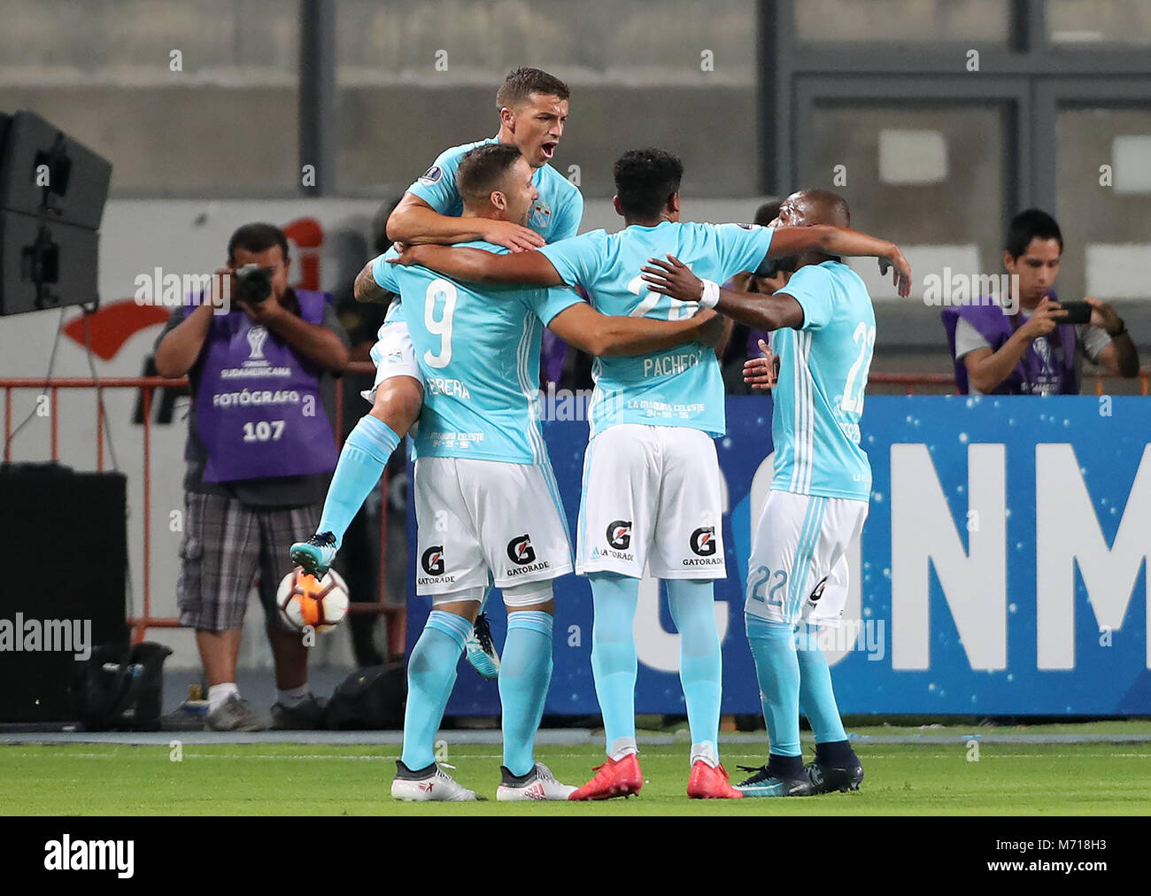 Sporting Cristal's players celebrate after scoring during the Copa Sudamericana soccer match between Sporting - Stock Image