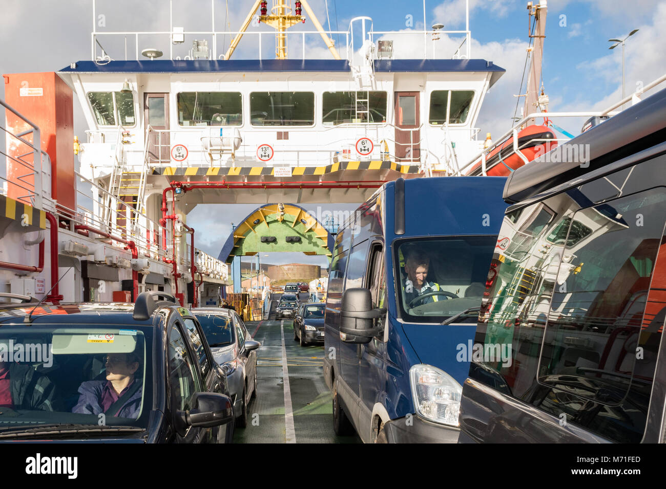 vehicles embarking on Orkney Ferries ferry at Lyness Orkney Ferry Terminal, Hoy, Orkney Islands to travel to Houton - Stock Image
