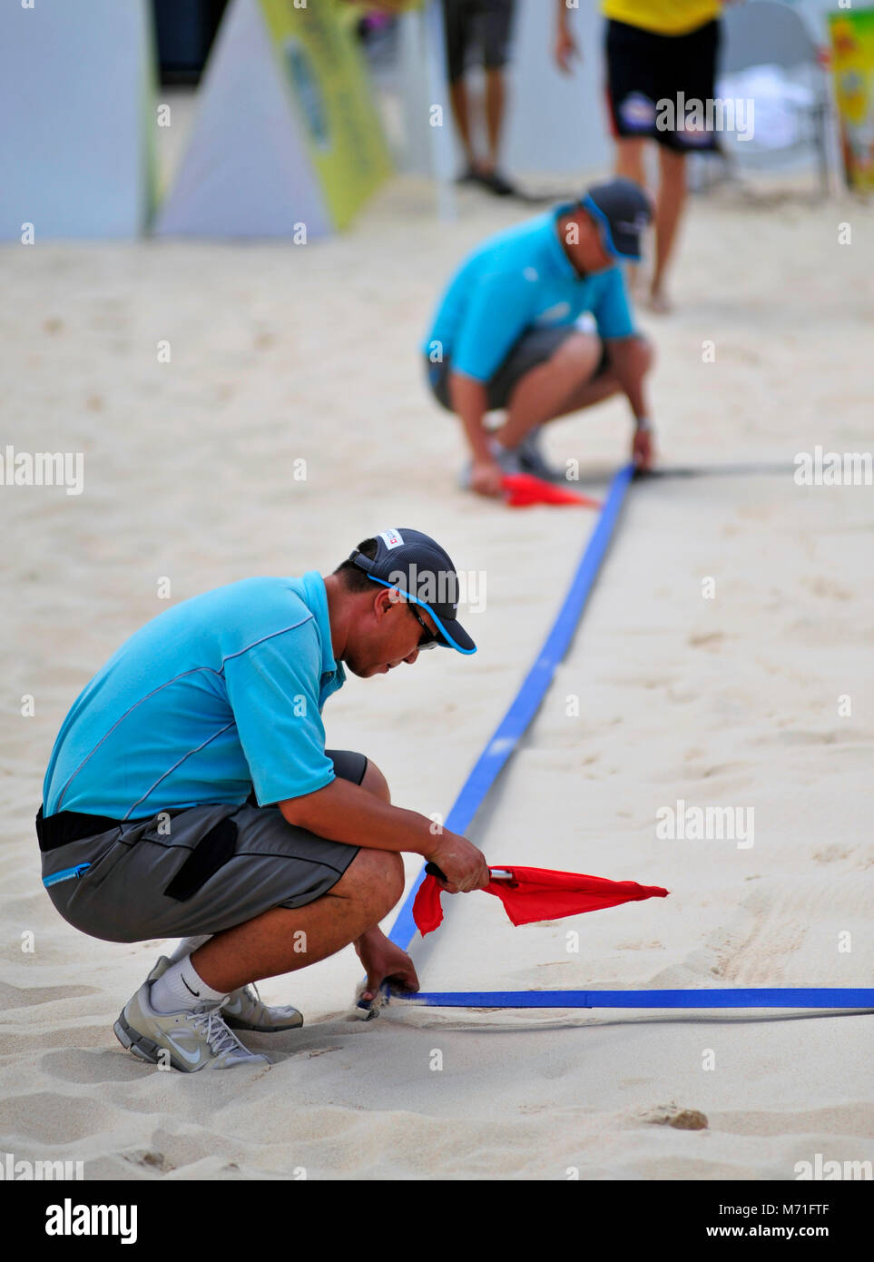 Referees mark the court boundaries at the Beijing Grand Slam Beach Volleyball tournament 2011 - Stock Image