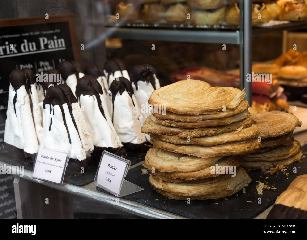 Beautiful Cakes and Pastries on Display in a Window of a Patisserie Bakery Shop in Morzine Haute Savoie Portes du - Stock Image