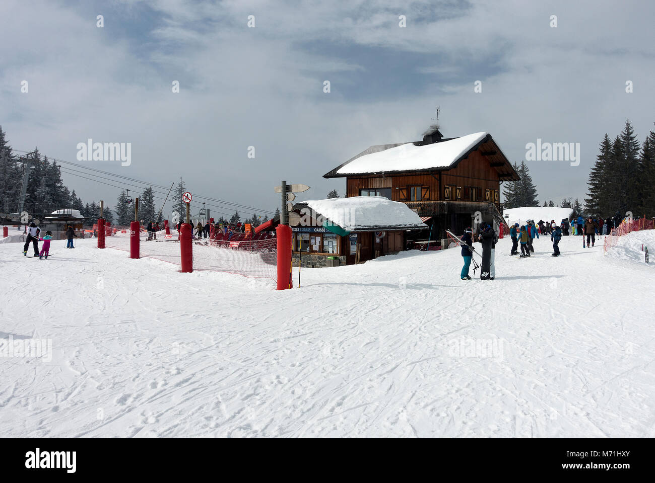 A Chalet Style Restaurant and Bar Facility with Chairlift Ticket Sales Office at Les Gets Ski Resort Haute Savoie - Stock Image