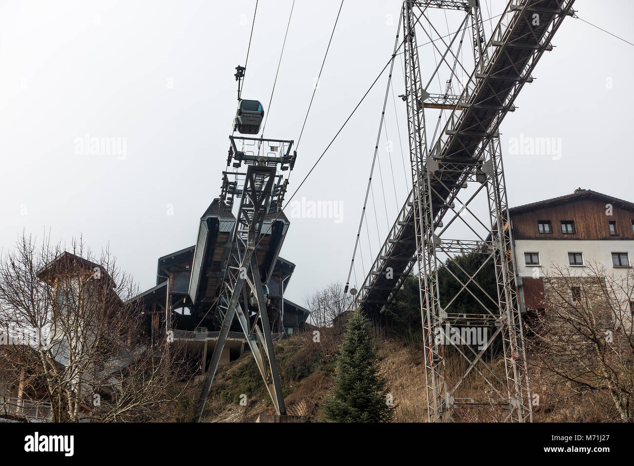 A Gondola Running Alongside a Suspension Bridge Walkway in the Ski Resort of Morzine Portes du Soleil Haute Savoie - Stock Image