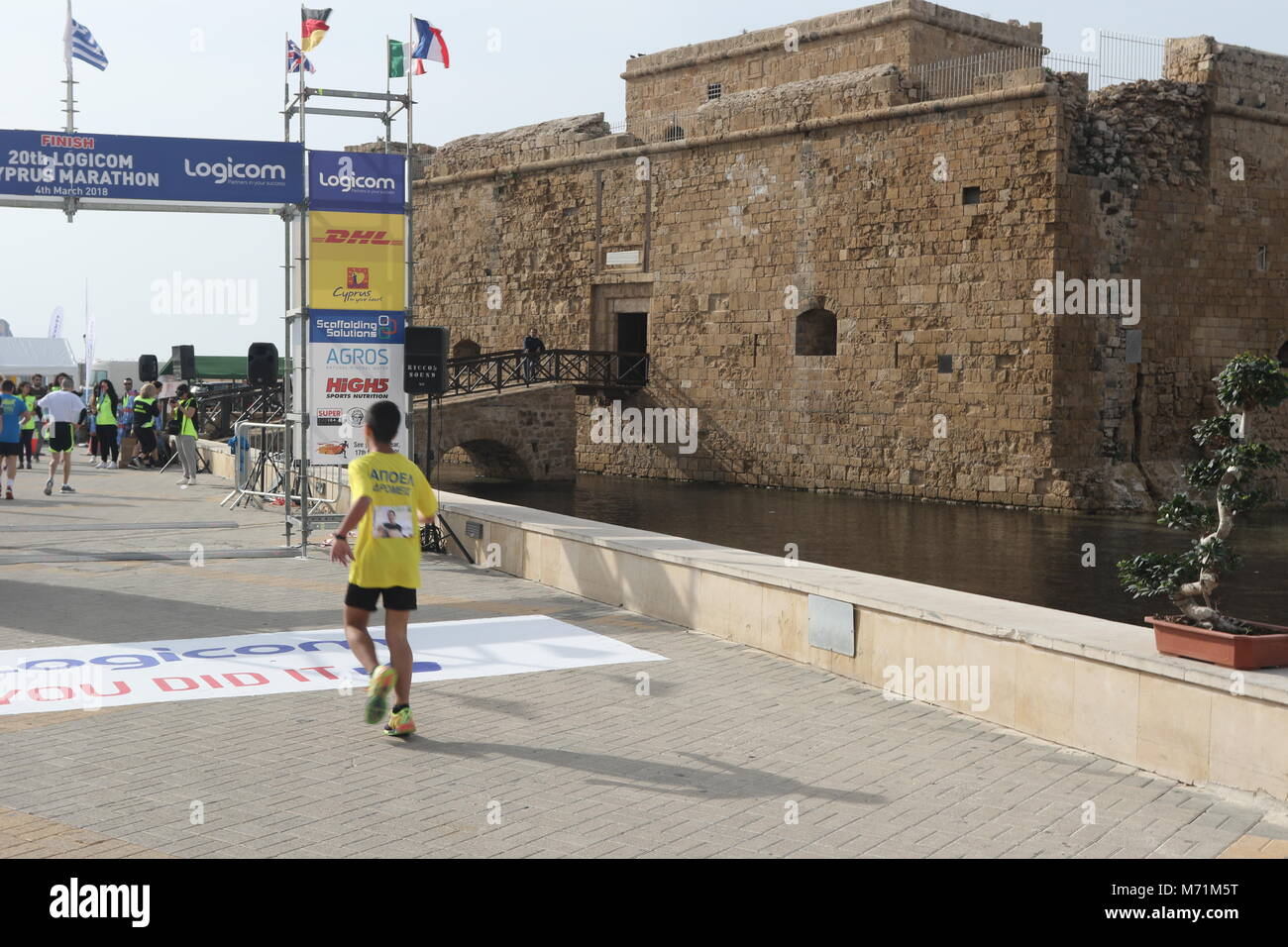 Finishing the 20th Logicom Cyprus marathon, half marathon, 10KM, 5KM fun run for international competitors at the - Stock Image
