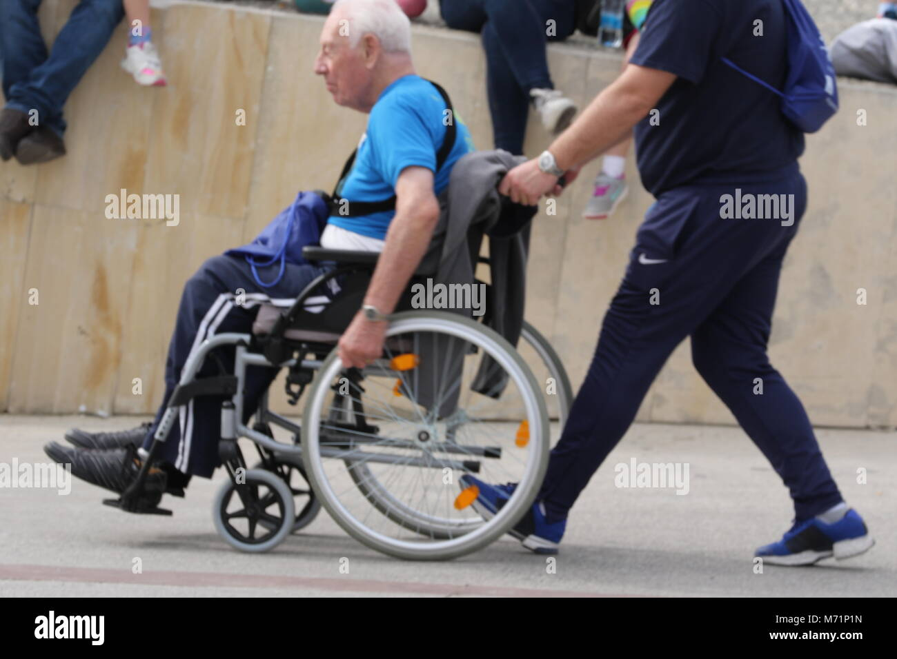 Wheelchair competitor at the 20th Logicom Cyprus marathon, half marathon, 10KM, 5KM fun run for international competitors - Stock Image