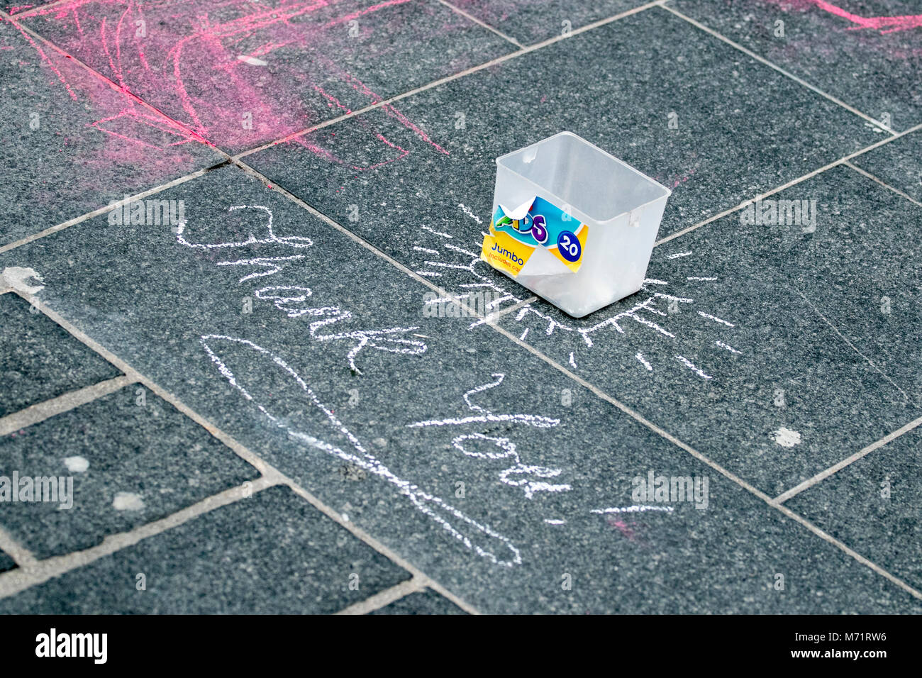 an artists chalk drawing donation tin cash giving money donations donation street Liverpool thank you writing - Stock Image