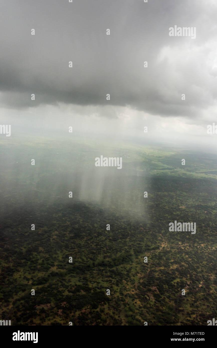 Aerial shot of a rainstorm over the African bush, Serengeti, Tanzania - Stock Image