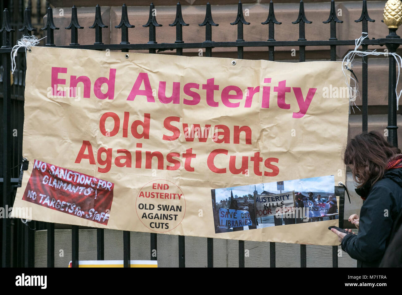 Anti austerity campaign banner banners placard placards union pension cuts demo demonstration liverpool city centre Stock Photo