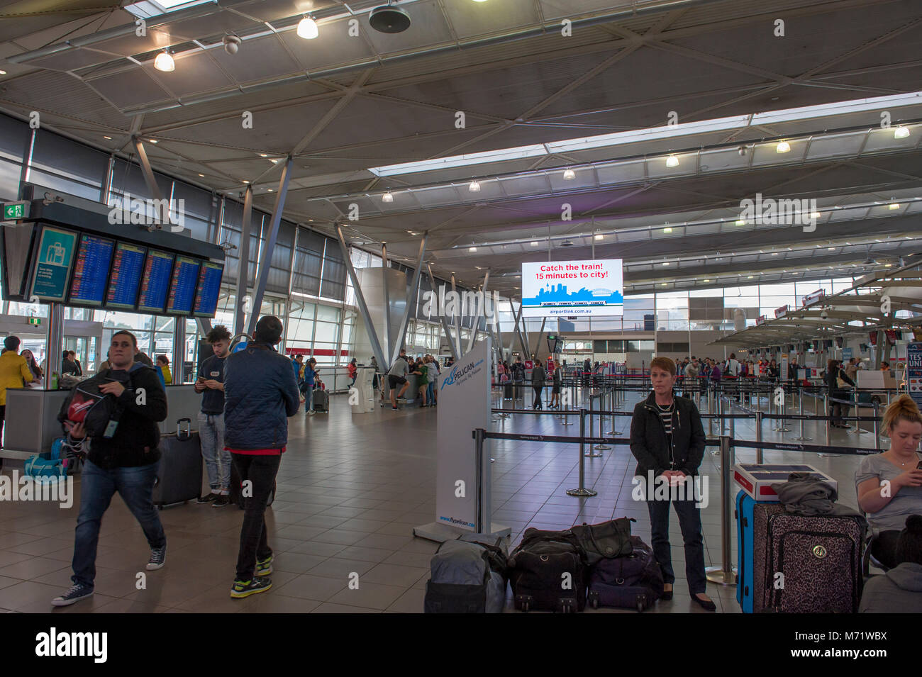 Airport sign at Sydney Airport.Check in area.  Electronic sign and electronic billboard. Mascot. AUSTRALIA Stock Photo