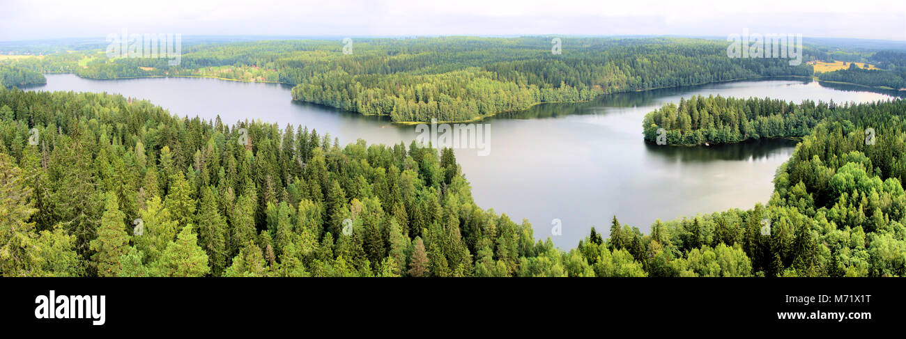 Panoramic aerial view of a lake among the forests of Finland - Stock Image