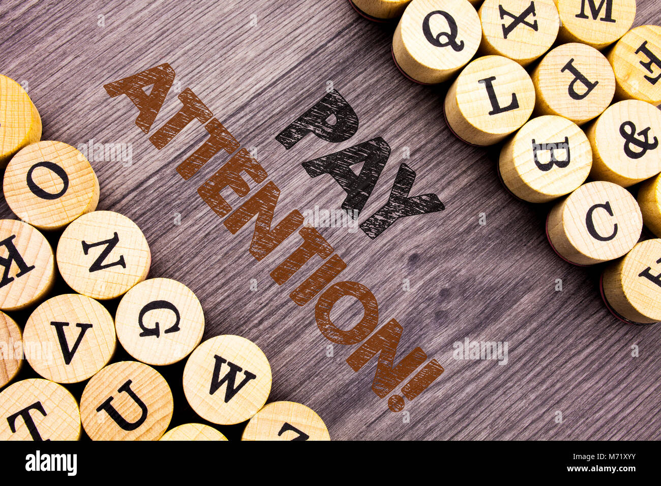 Conceptual hand writing text showing Pay Attention. Concept meaning Be Careful Beware Mindful Alarm written wooden - Stock Image