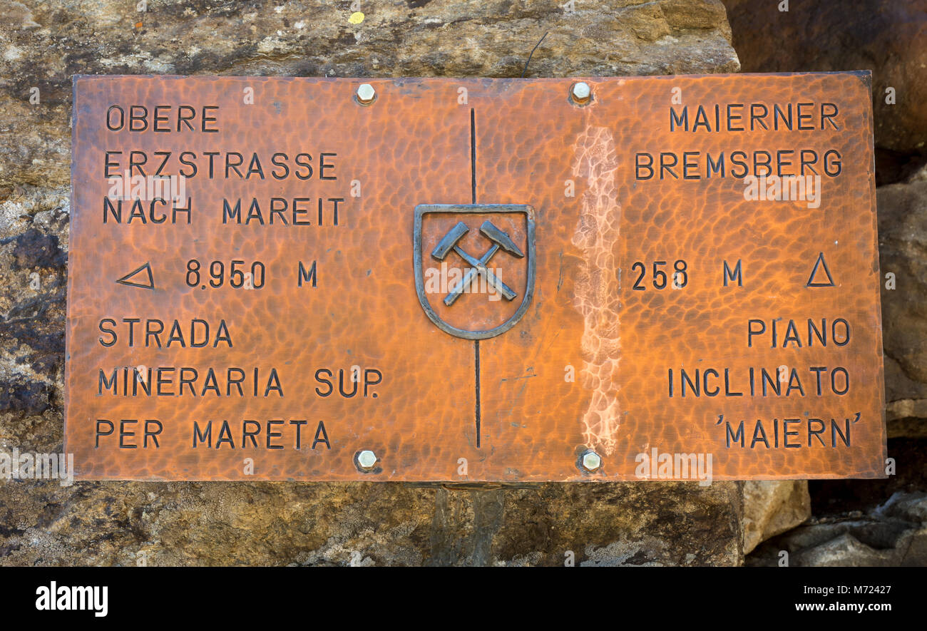 Ridnaun Valley in South Tyrol,Italy-may 27,2017: old rusty sign in the path of the mines Ridnaun Valley. Place where - Stock Image
