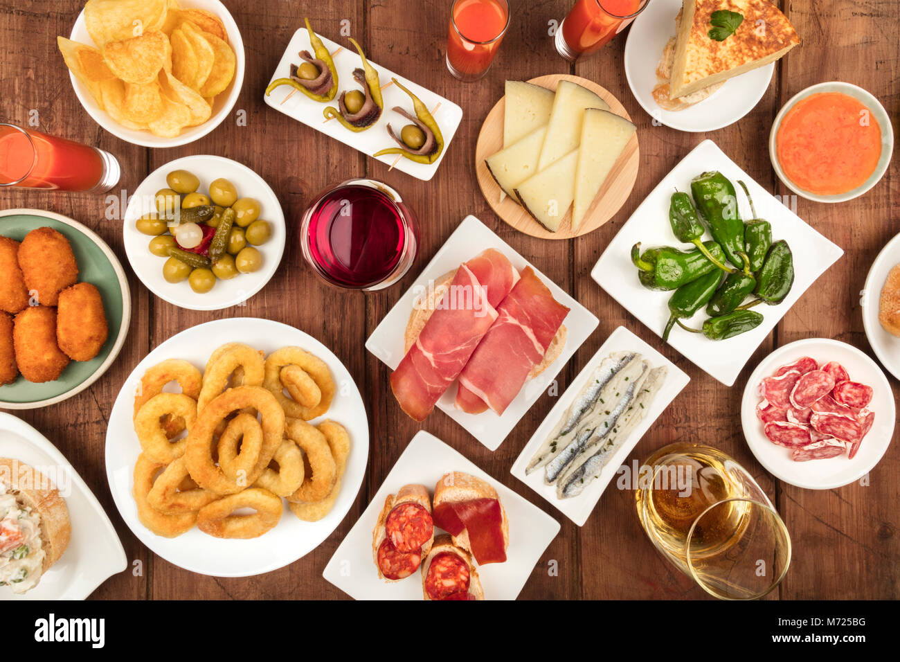 The food of Spain. Overhead photo of many different Spanish tapas - Stock Image