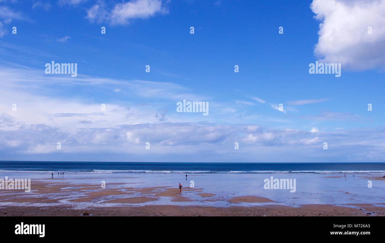Spacious views across a beach with beautiful big sky and sand - Stock Image