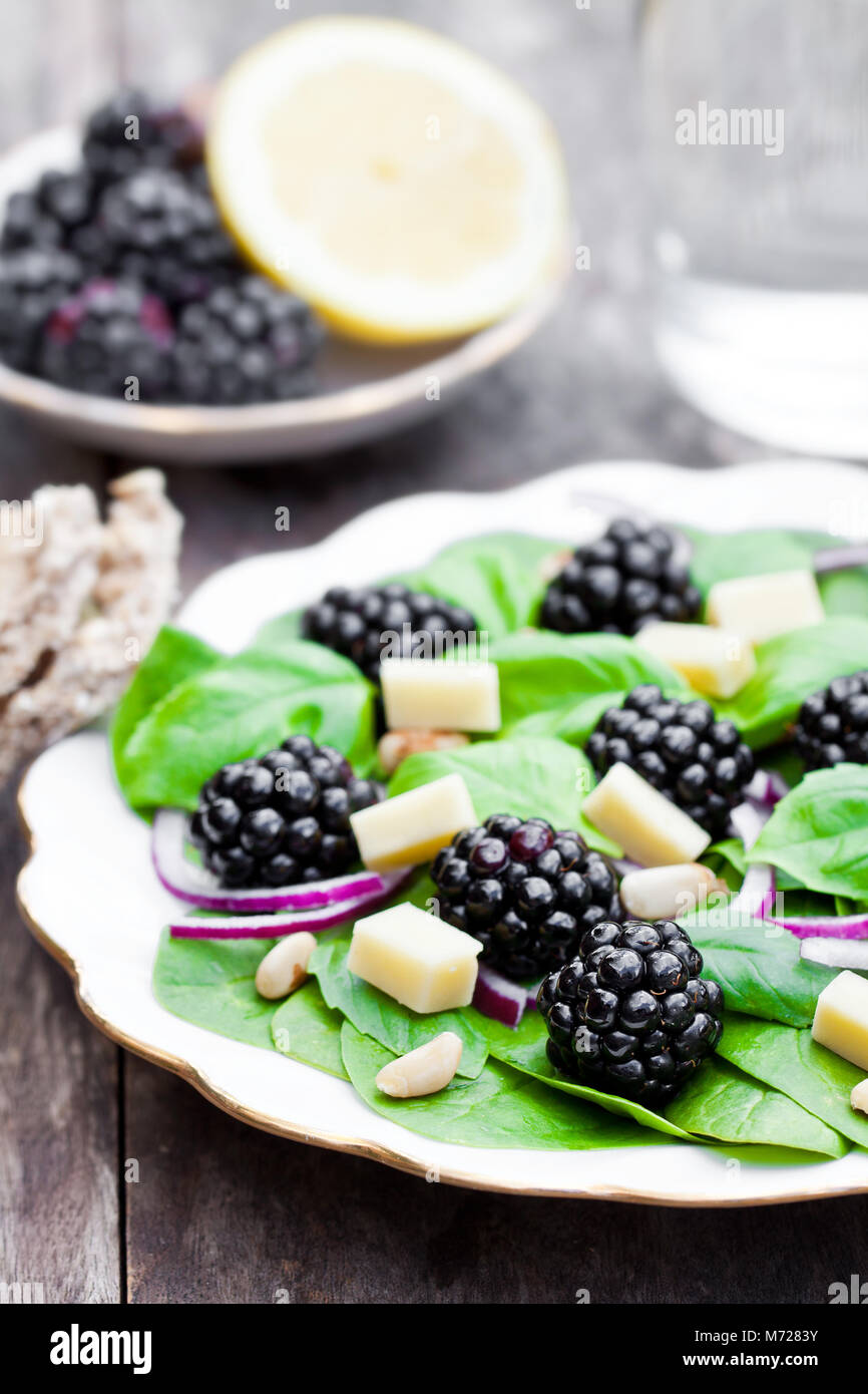 Seasonal  leaf salad with cheese and blackberries - Stock Image