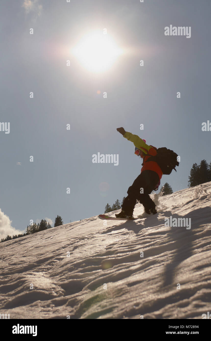 snowboarder riding in swiss alps Stock Photo