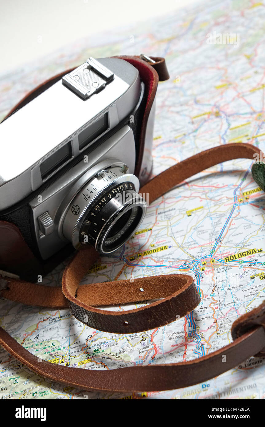 old retro style 35mm rangefinder camera on map of italy - Stock Image