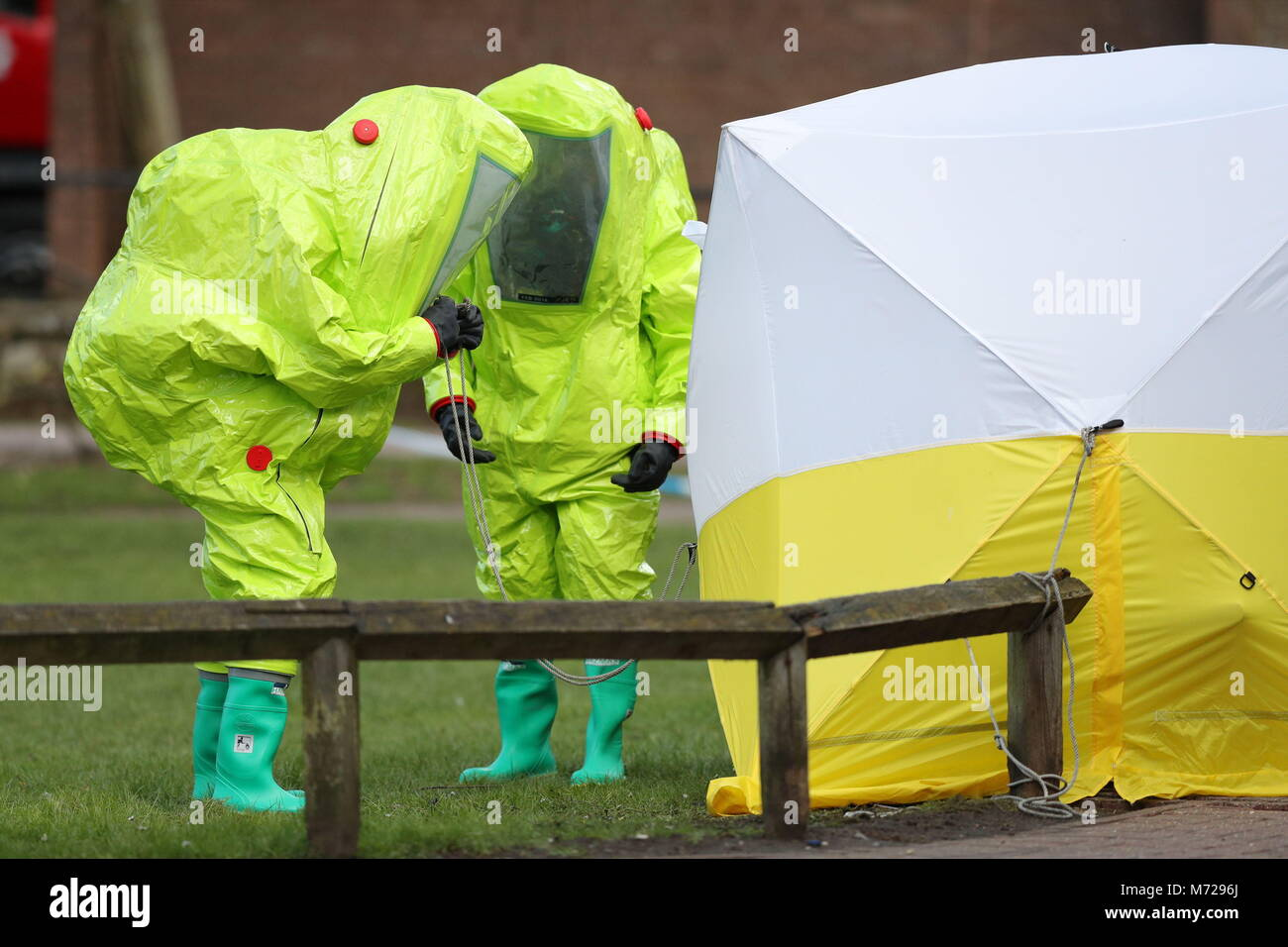 Personnel in hazmat suits work to secure a tent covering a bench in the Maltings shopping centre in Salisbury where former Russian double agent Sergei ... & Personnel in hazmat suits work to secure a tent covering a bench in ...