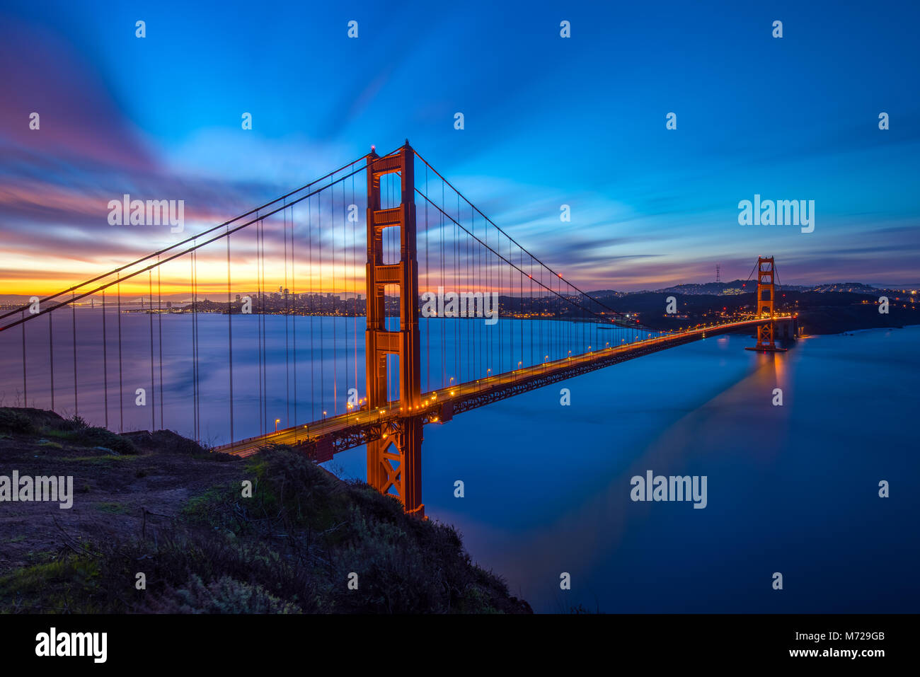 Golden Gate Bridge Panoramic Sunrise View with Great Dynamic Sky - Stock Image