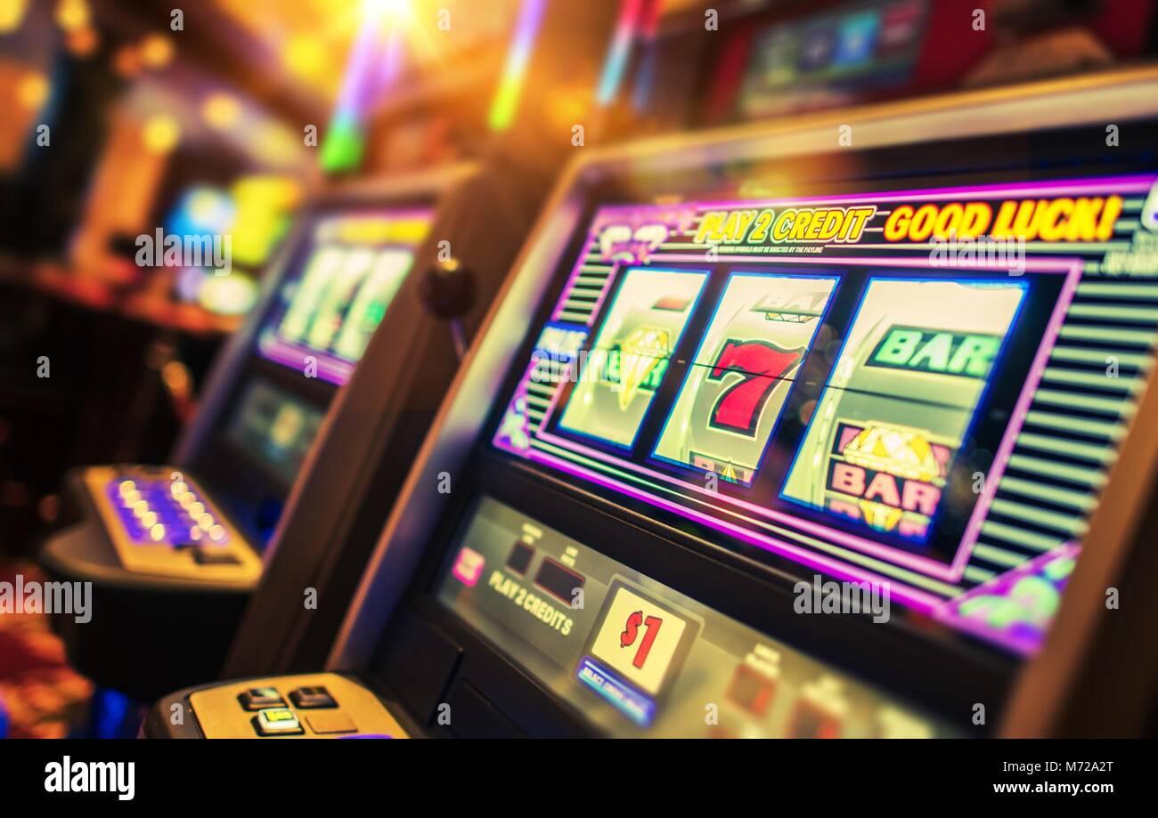 Casino Interior and Row of Classic Slot Machines. Las Vegas Gambling Theme. - Stock Image