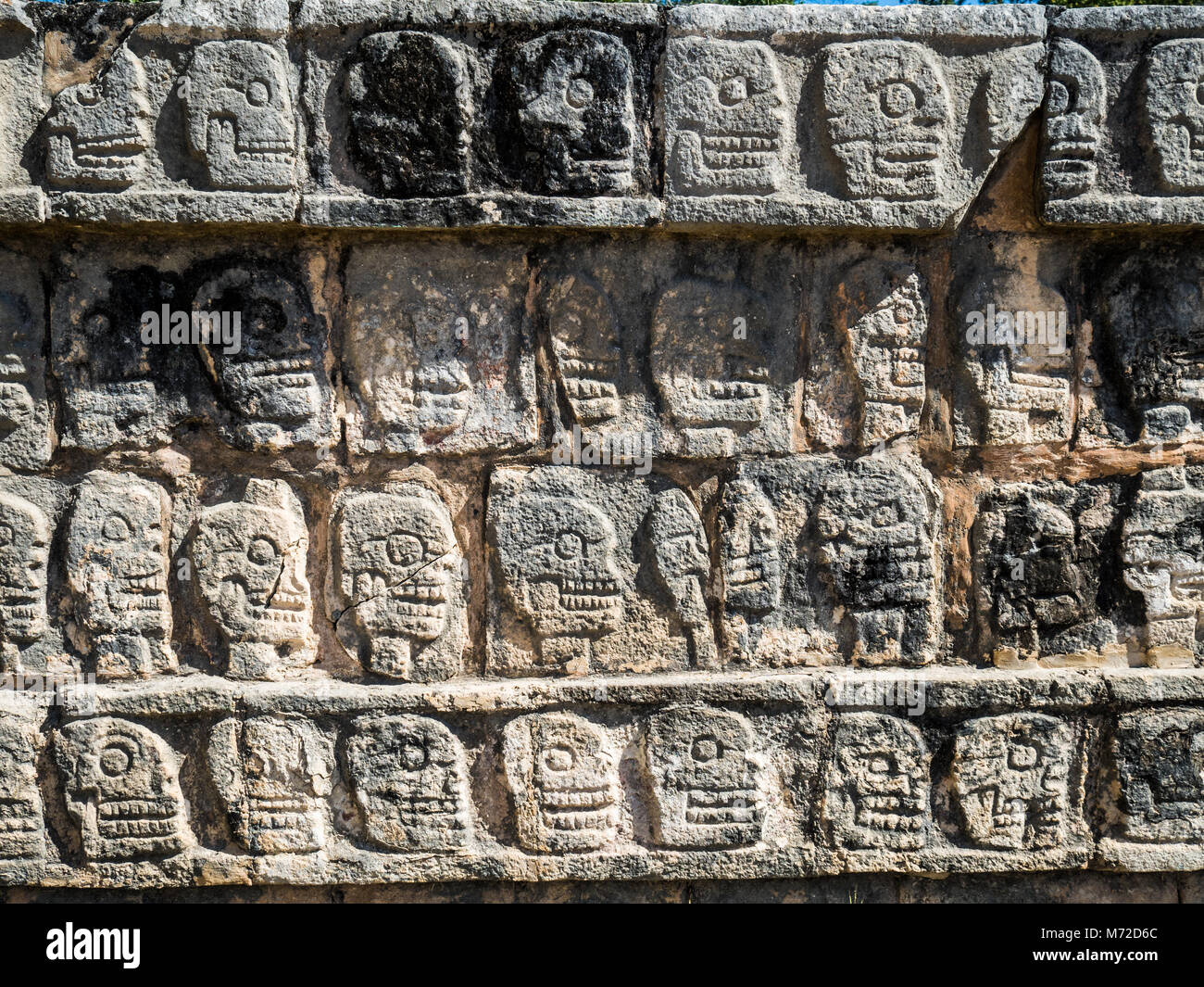 Tzompantli, the Wall of the Skulls, was the base of a structure used for human sacrifice in the Chichen Itza Mayan Stock Photo