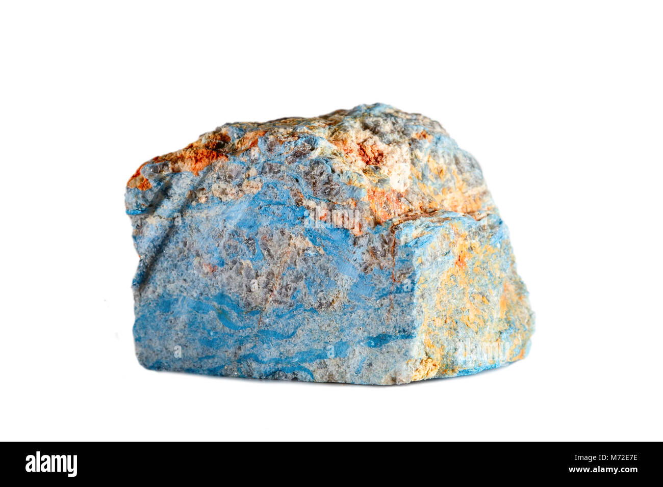 Macro shooting of natural gemstone. Raw mineral dumortierite. Madagascar. Isolated object on a white background. - Stock Image