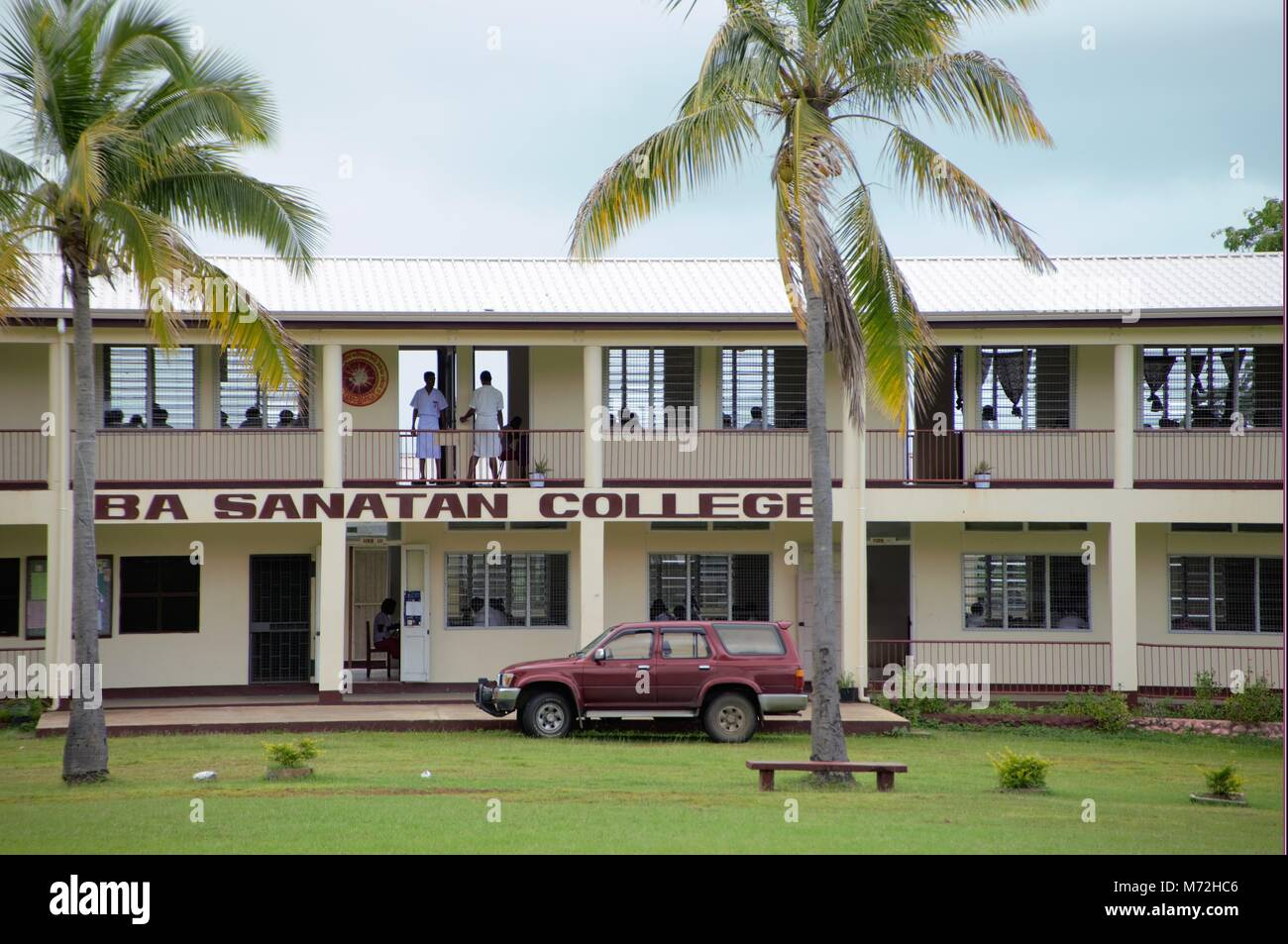 A typical whitewashed secondary school in Fiji. The attractive design helps to ventilate the classrooms from the Stock Photo