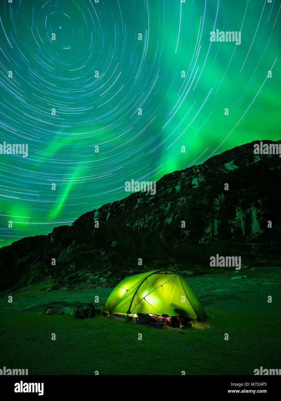 Sleeping under spinning stars - Stock Image