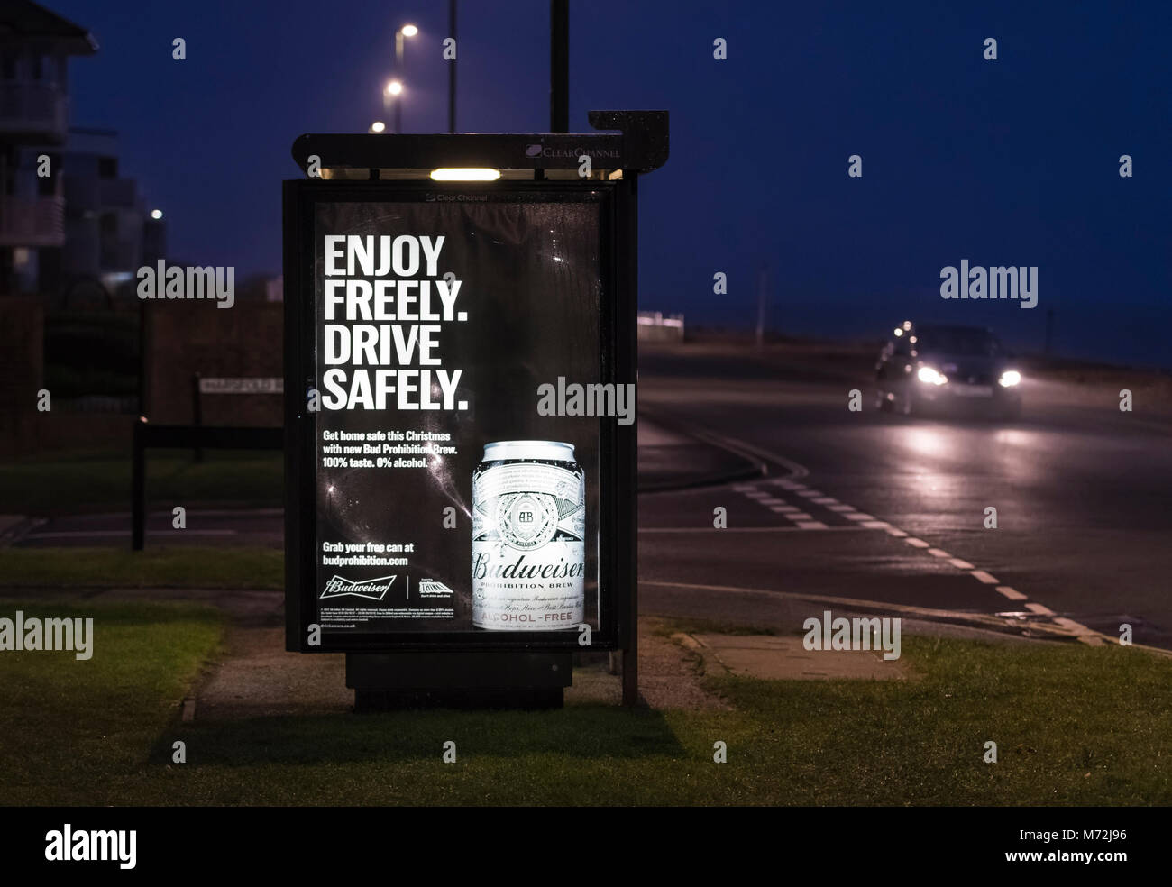 Advertisement poster by a road for Budweiser Prohibition Brew (alcohol free beer) on a bus stop shelter in the UK. - Stock Image