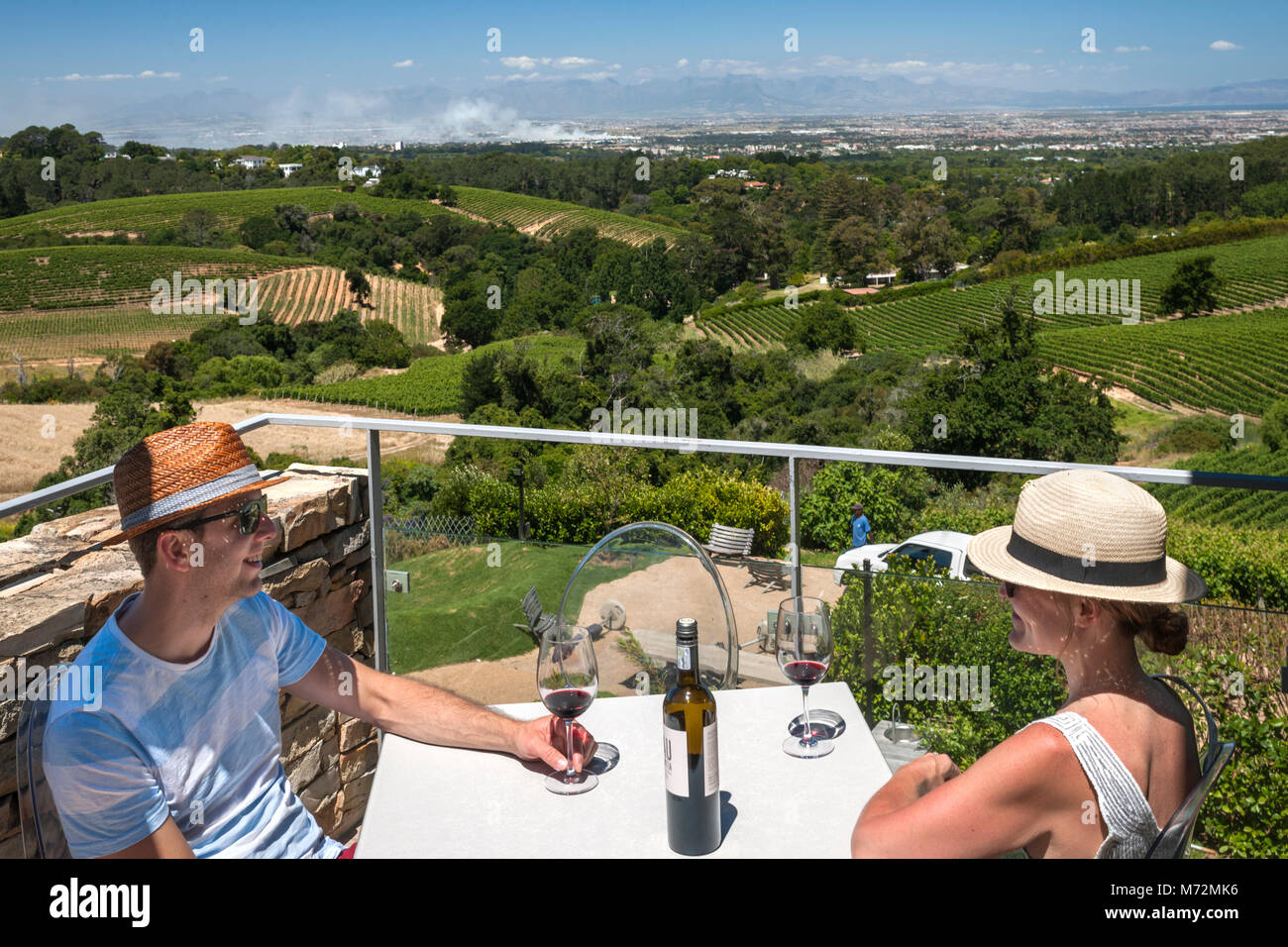Couple on the terrace of Beau Constantia wine estate in Constantia, Cape Town. - Stock Image