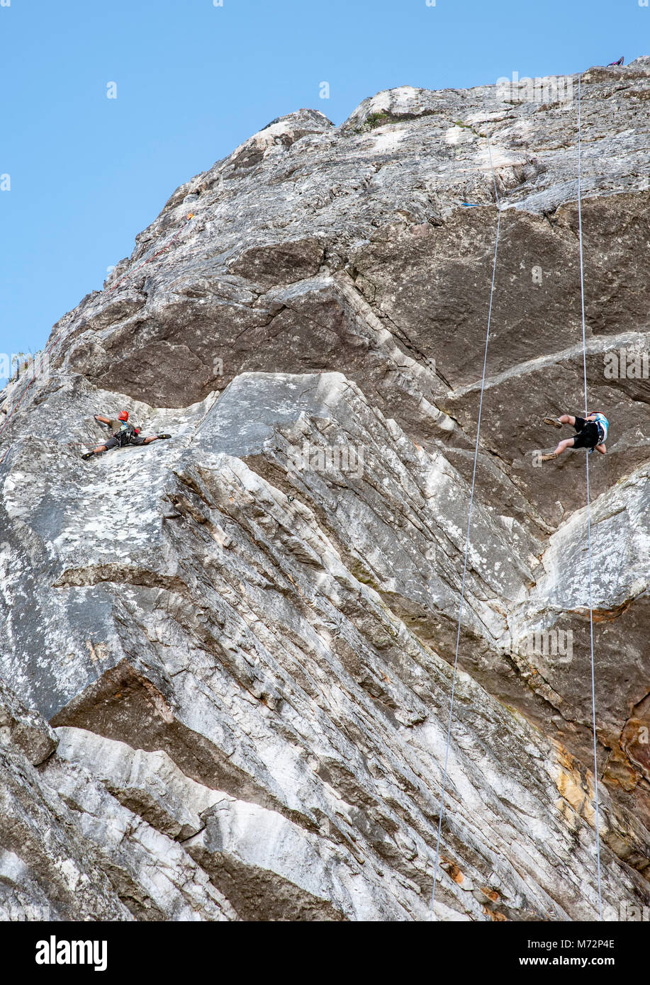 Abseilers and rock climbers just below the summit of Table Mountain in Cape Town. Stock Photo