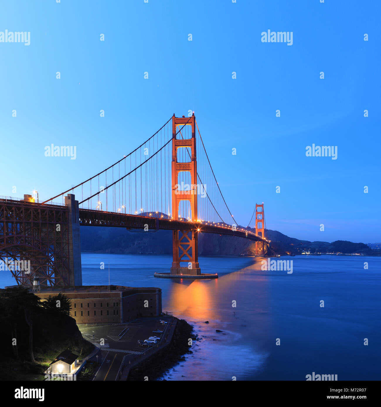 A Square format of the Golden Gate Bridge as darkness falls - Stock Image