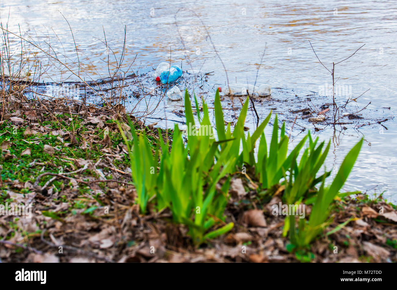 Plastic garbage in the river , pollution and environment concept - Stock Image