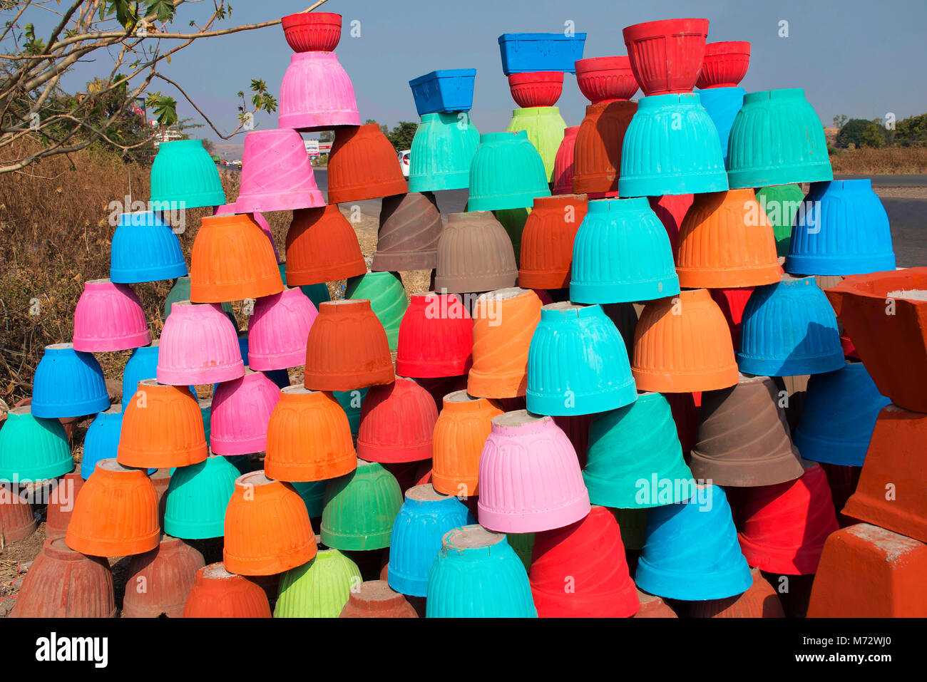 Earthen pots of different colors for sale. Pune district, Maharashtra, India - Stock Image