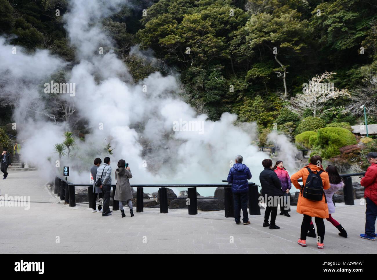 Tourist looking at the Umi Jigoku ( Ocean Hell ) hot spring in Beppu, Japan. - Stock Image
