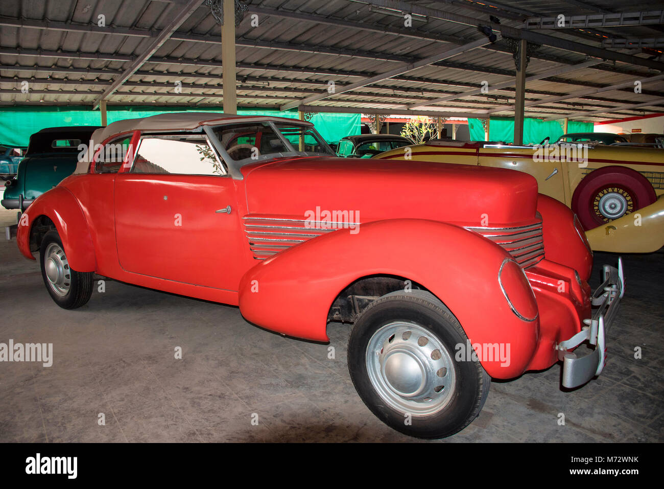 Coral colored antique car in Auto World Vintage Car Museum of Stock ...