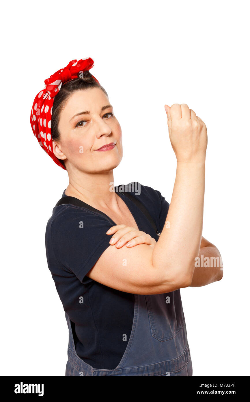 Self-confident middle aged woman with dungarees isolated on white background, text space, tribute to american worker - Stock Image