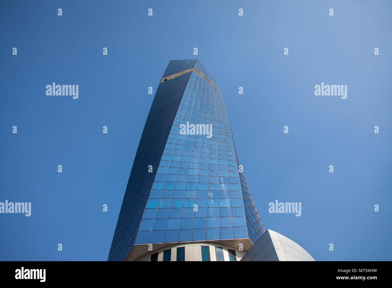 SARAJEVO, BOSNIA HERZEGOVINA - FEBRUARY 16, 2018: Sun reflecting on Avaz Twist Tower during a sunny afternoon. Avaz Stock Photo