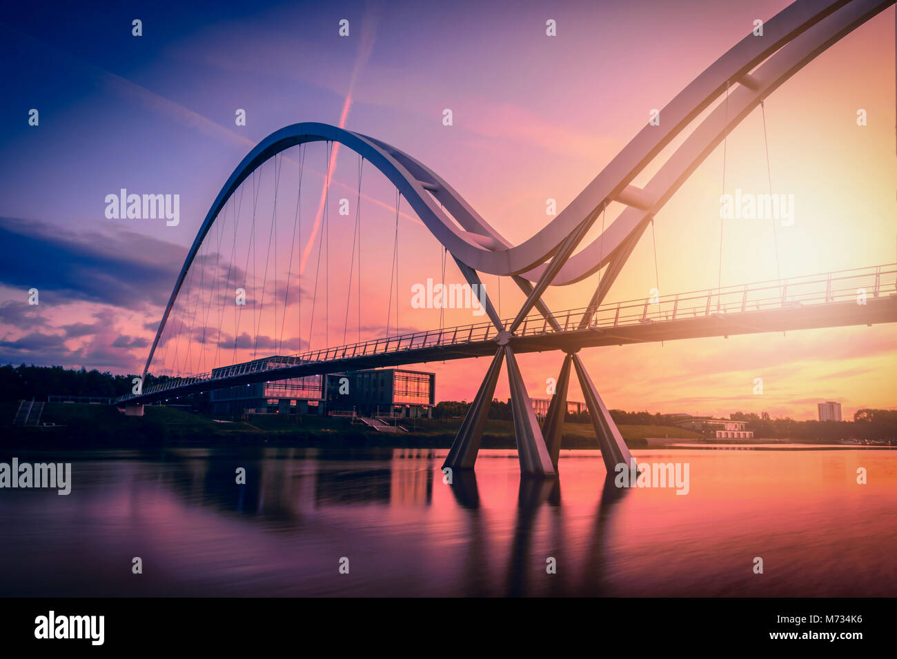 Infinity Bridge on dramatic sky at sunset in Stockton-on-Tees, UK. Stock Photo