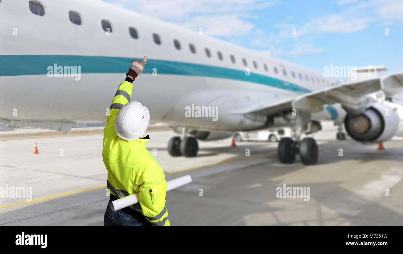 A Technician engeneer inspection an aircraft at an airport - Stock Image