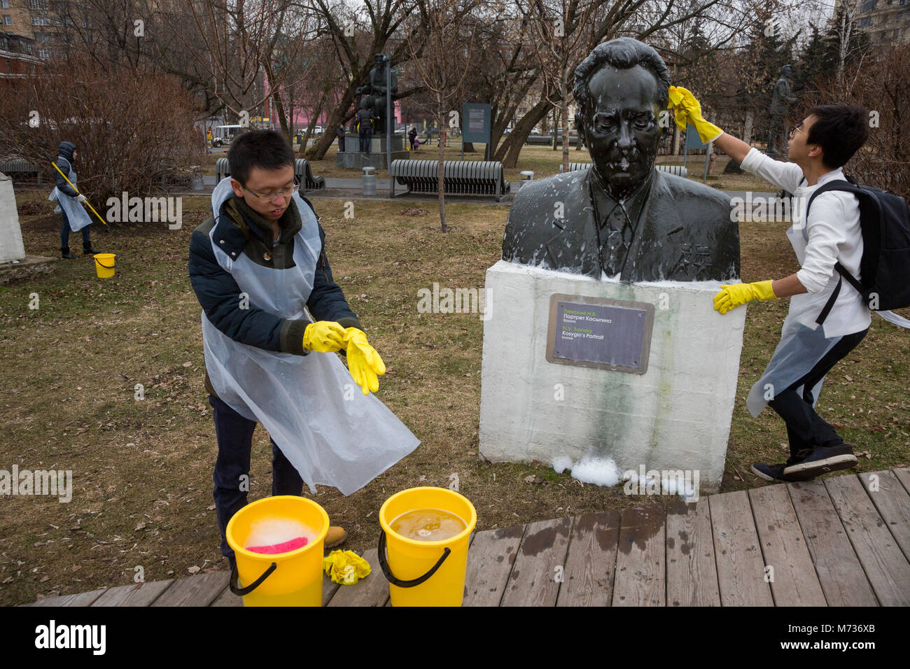 Chinese students wash bust of soviet statesman  Alexei Kosygin during annual spring event (Subbotnik) in Moscow's - Stock Image