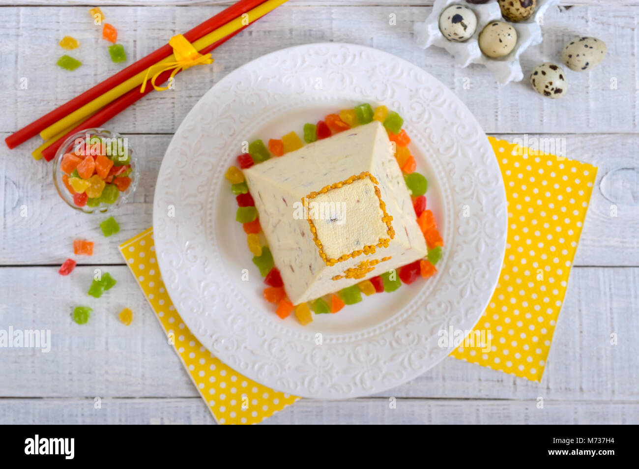 Traditional curd Easter cake with candied fruits on the holiday light background. Easter cottage cheese dessert. - Stock Image