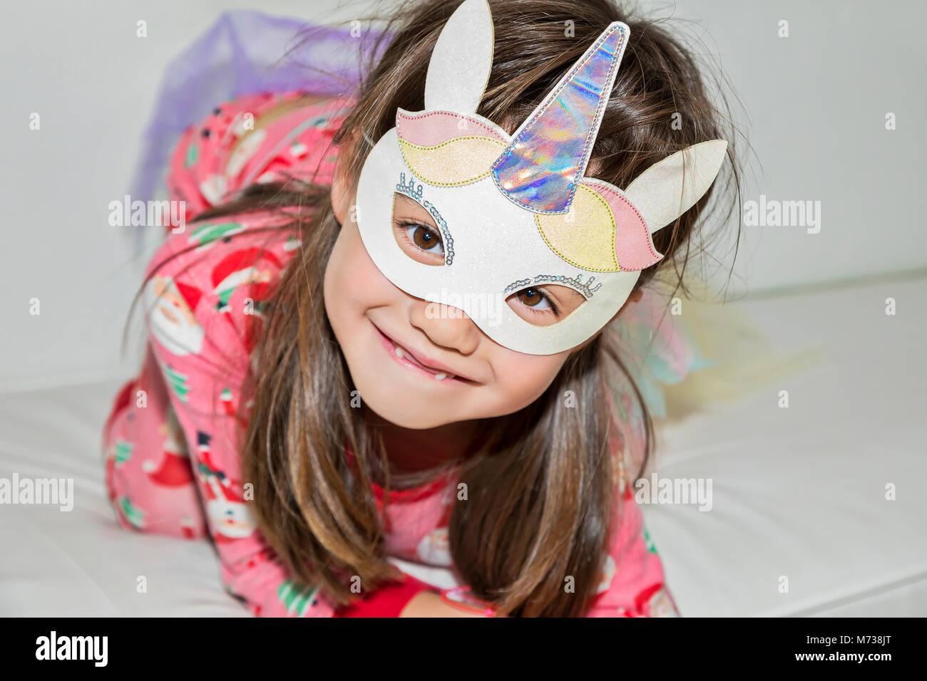 A six year old girl wearing a unicorn costume Stock Photo