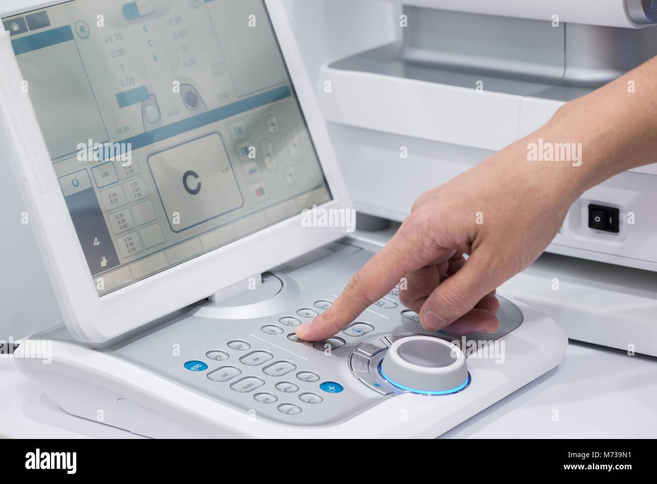 doctor oculist at work. diagnostic ophthalmologic equipment. medicine concept - Stock Image