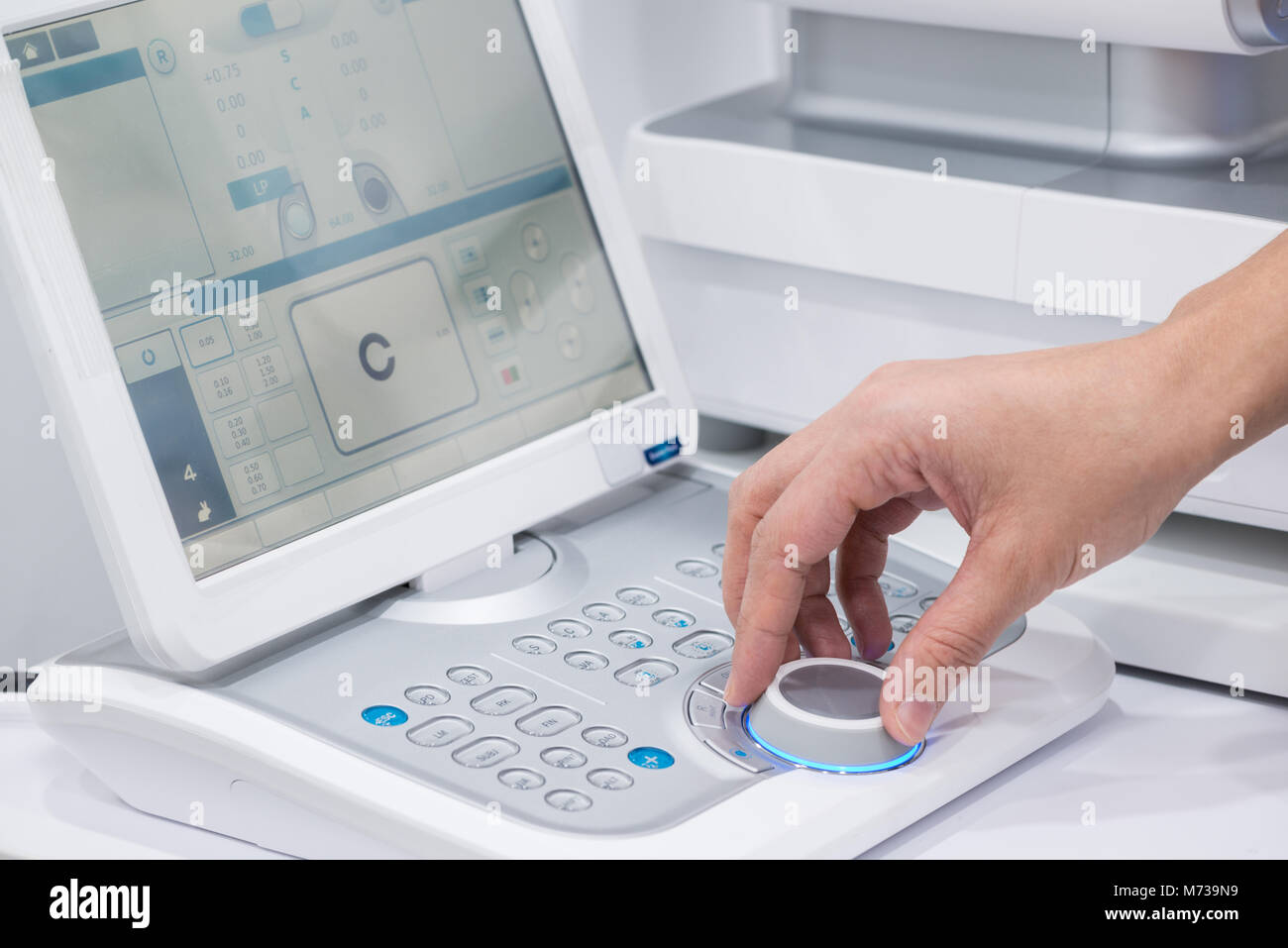 doctor oculist at work. diagnostic ophthalmologic equipment. medicine concept - Stock Image