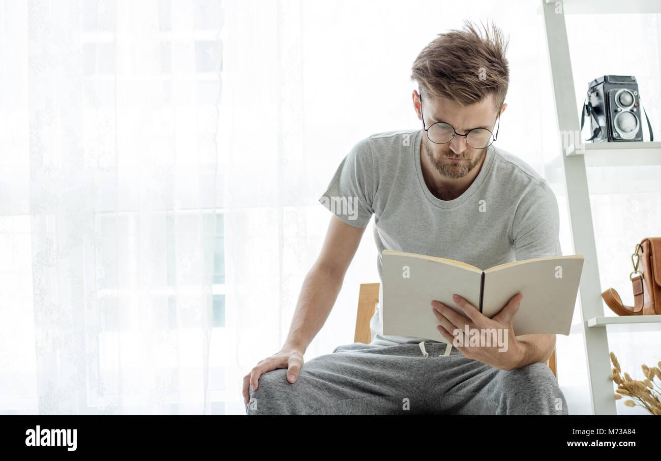 Men Read Book In Livingroom Stock Photo 176480196 Alamy