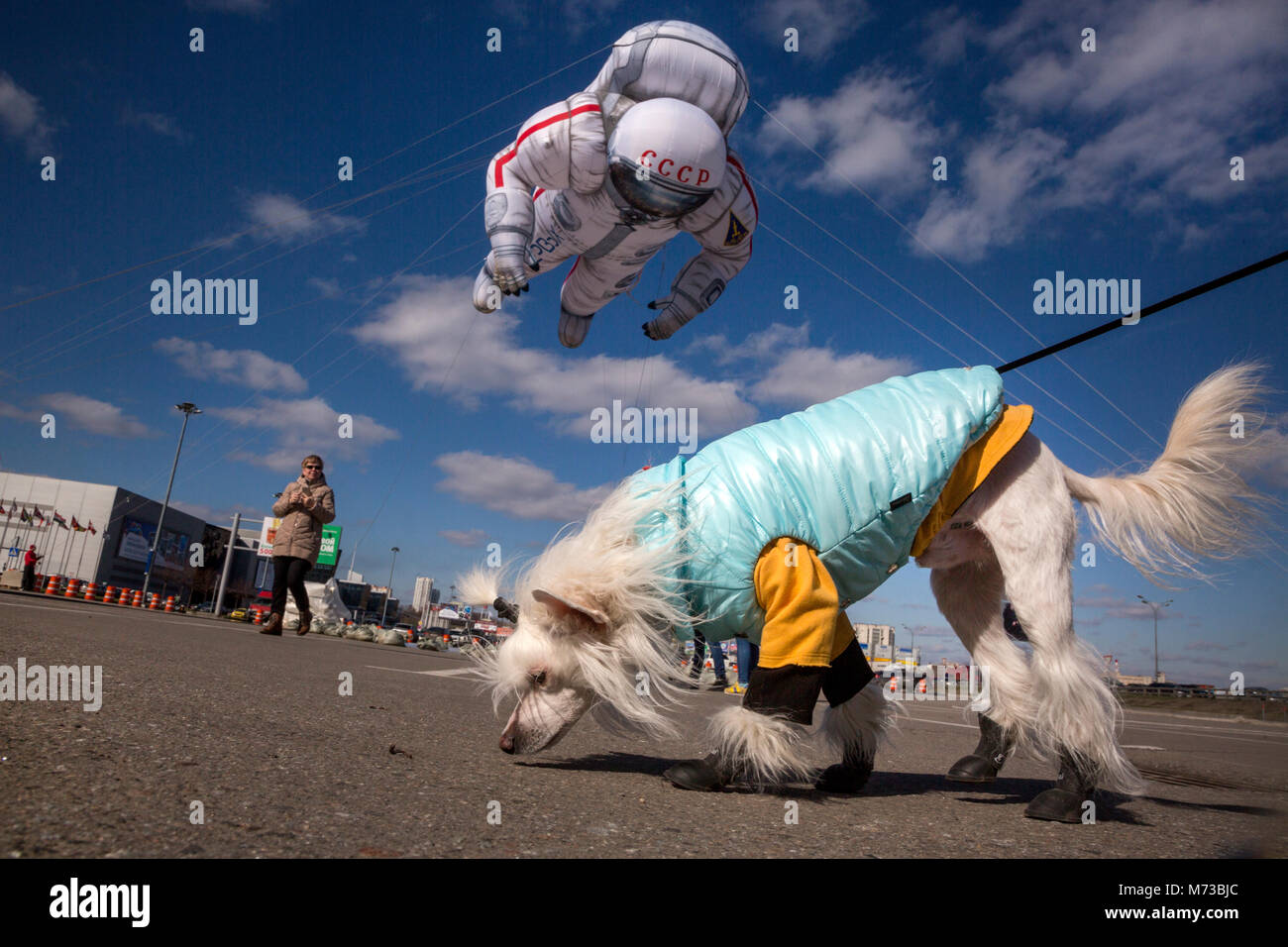 A balloon in the form of a Soviet cosmonaut flies over in Moscow city, Russia - Stock Image