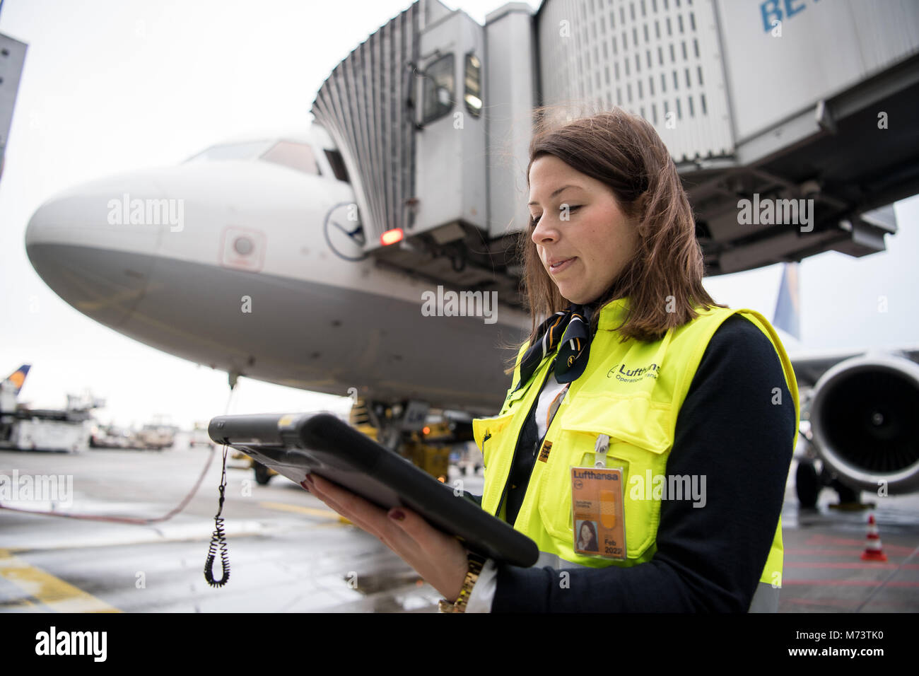 08 March 2018, Germany, Frankfurt: Christiana Schultheis, ramp manager, monitoring the loading of the Lufthansa - Stock Image