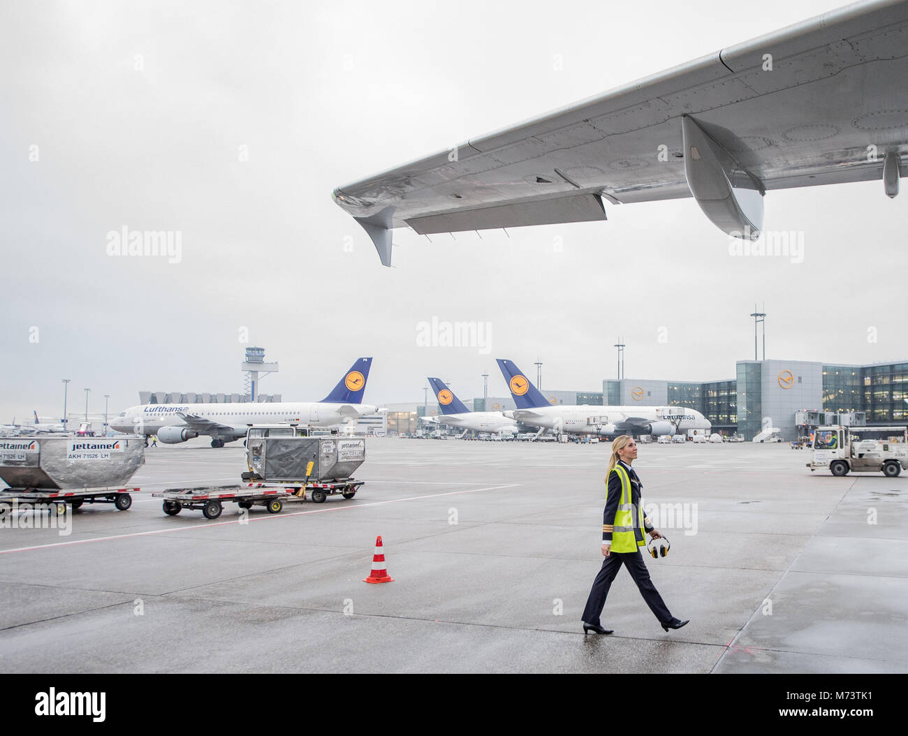 08 March 2018, Germany, Frankfurt: Laura Grammes, co-pilot, checking the airoworthiness of the Lufthansa Airbus - Stock Image