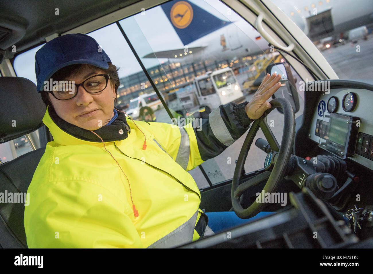 08 March 2018, Germany, Frankfurt: Danuta Keller, luggage driver, driving the luggage for the Lufthansa Airbus A - Stock Image
